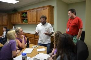 Eddie advising the group on the Solomon context.